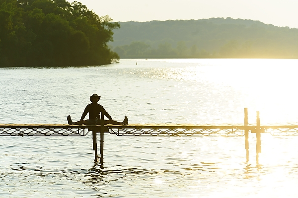 The limnology pier on Lake Mendota becomes the perfect place to stretch one's legs and enjoy a July sunset.