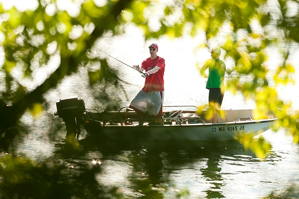 With sunlight dappling Lake Wingra near the UW-Madison Arboretum, two fishing enthusiasts hope for a bite.