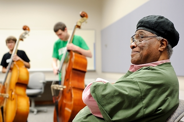 Photo: Students playing bass, Richard Davis listening
