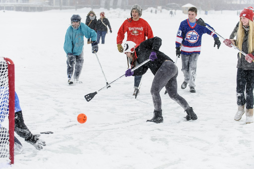 Teams of UW-Madison students compete during the Hoofer Winter Carnival Broomball Tournament on Lake Mendota.