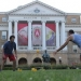 Players gather for a Spikeball game in front of Bascom Hall.