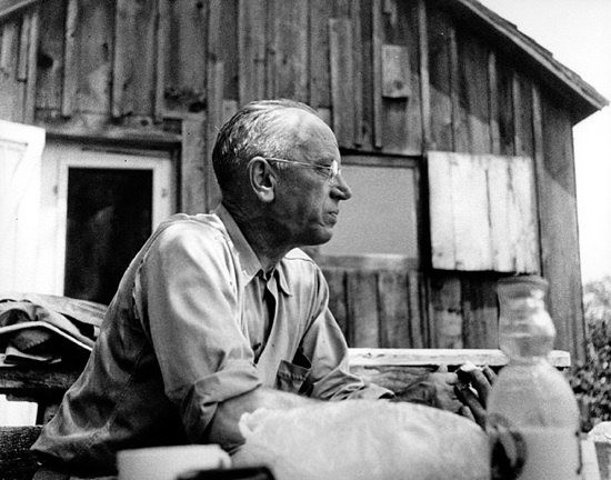 Aldo Leopold, a 20th-century conservationist and former UW–Madison faculty member, is shown at his Sauk County shack in about 1940.