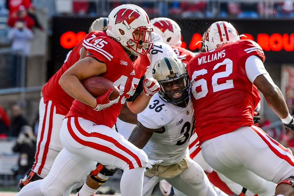 In the game, running back Alec Ingold (45) made his way into the end zone for a first-quarter touchdown — one of his two scores in Wisconsin's 24-7 win.