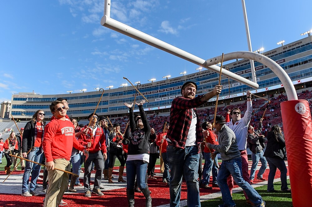 After running the length of the field, law students (including Marc Pawlus, in plaid) toss their canes over the south goal post before the game. Law School lore dating back to the 1930s holds that those who catch their cane on the other side will win their first case; those who don't will have to settle.