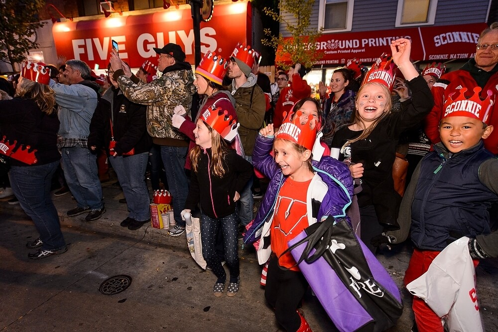 Young Badgers were among the most enthusiastic spectators as the parade floats and performers made their way toward campus.