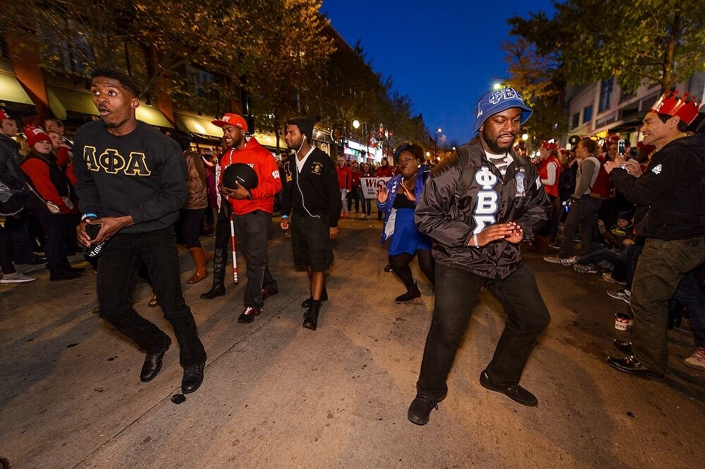 Members of several fraternities, including Alpha Phi Alpha and Phi Beta Sigma, danced their way down State Street as the procession continued.