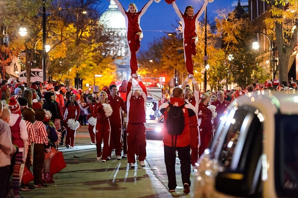 Members of the UW Spirit Squad performed one of their trademark balancing acts for the crowd with the illuminated State Capitol in the background.
