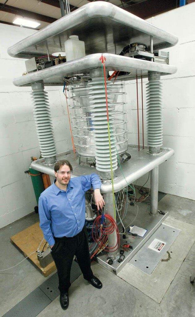 Photo: Piefer standing next to machine