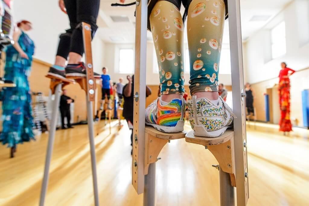 People walking on stilts