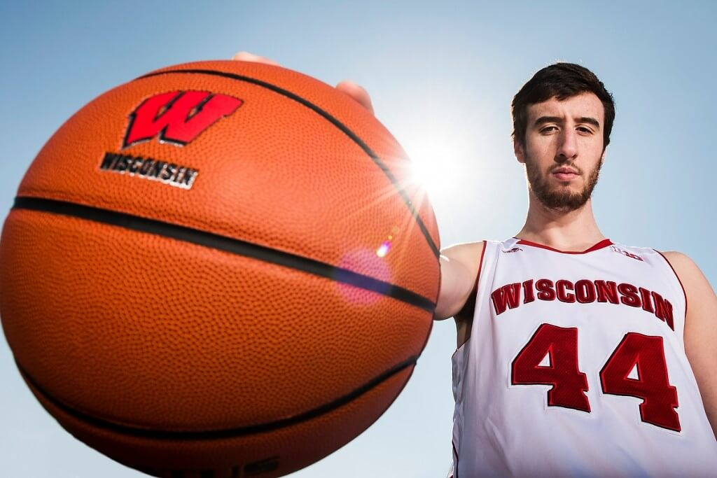 Big basketball, big accomplishments: Frank Kaminsky, who swept multiple national player honors, including the prestigious John R. Wooden Award, poses with one of the tools of his trade.