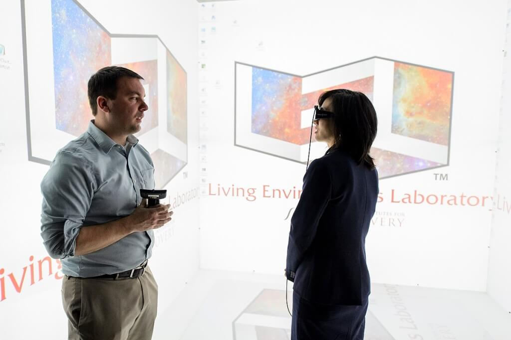 Goggles in place, Michelle K. Lee, right, director of the U.S. Patent and Trademark Office, tours the Discovery Building's Living Environments Laboratory with faculty member Kevin Ponto.