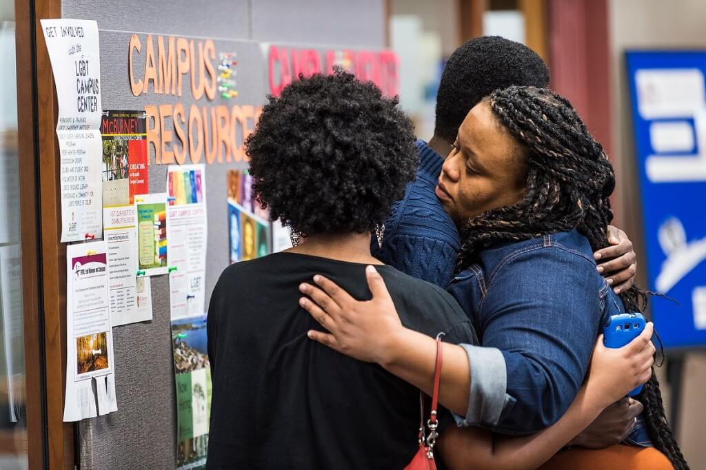 Karla Foster, coordinator for African American Student Academic Services, comforts students after a May announcement that no charges would be brought related to the death of Tony Robinson, an African-American Madison man shot by a Madison police officer.