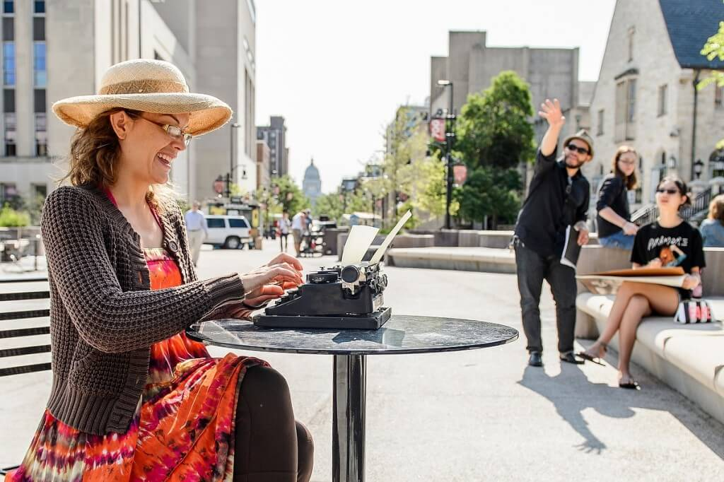 In an unexpected display of multitasking, Sarah Krause, an artist's model, uses a manual typewriter while sitting on Library Mall for assistant professor Leslie Smith III's life drawing class.