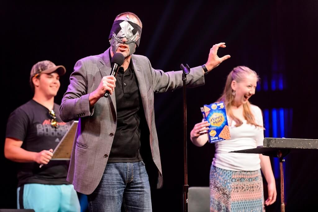 Wow! Students react with amazement as a blindfolded mentalist identifies items collected from the audience during a Wisconsin Welcome event held at the Overture Center.