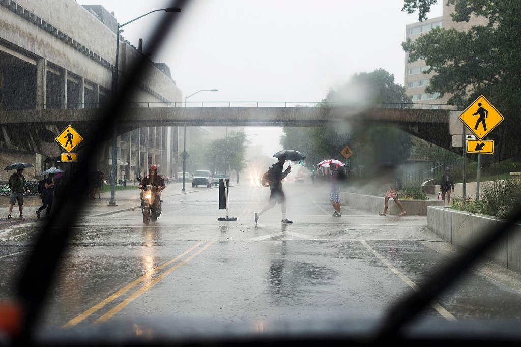 Thanks go to umbrella makers as pedestrians hustle through heavy rain on Park Street during a stormy September morning.