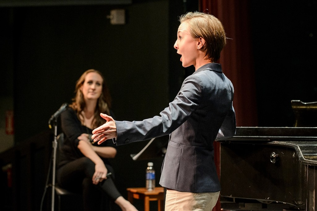 With arms open wide and notes pouring out, UW student Alaina Carlson, right, performs for School of Music alumna Brenda Rae during a master class in Music Hall.