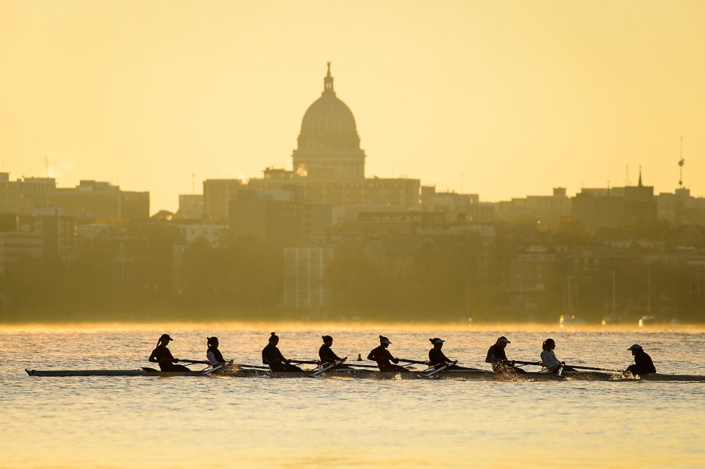 This is the reward for getting up before dawn: a view of women's crew rowing along Lake Mendota with the downtown Madison skyline as the backdrop.
