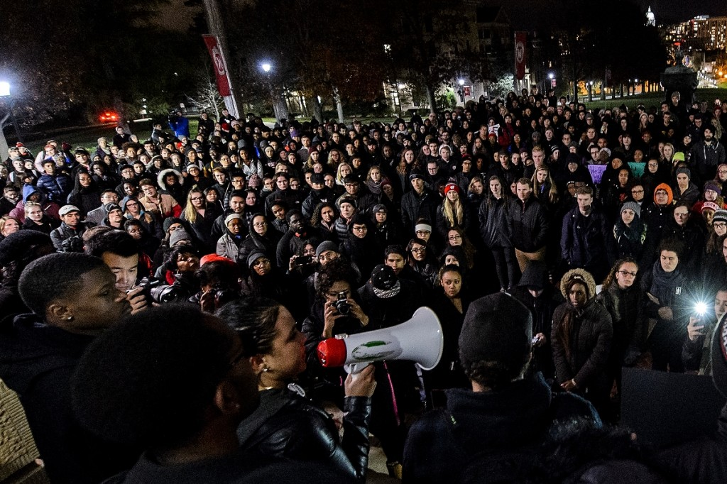 Undeterred by a blustery November night, hundreds of UW students and community members gather on Bascom Hill for a Black Out March held to support African-American students at the University of Missouri.