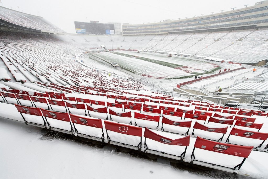 Mother Nature meets Wisconsin football as UW Athletics staff clear the outcome of a November snowstorm before the Badgers' final home game at Camp Randall Stadium.