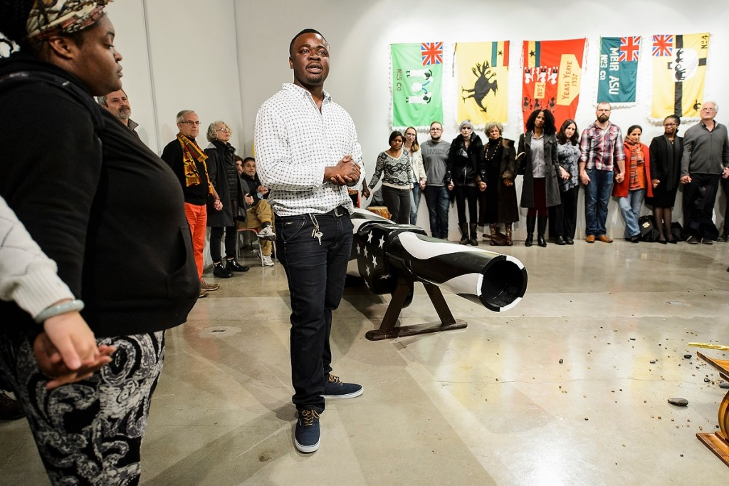 As a symbol against gun violence, artist in residence Eric Adjetey Anang invites guests to help break the barrel of the gun-shaped coffin that he created at the Art Lofts.