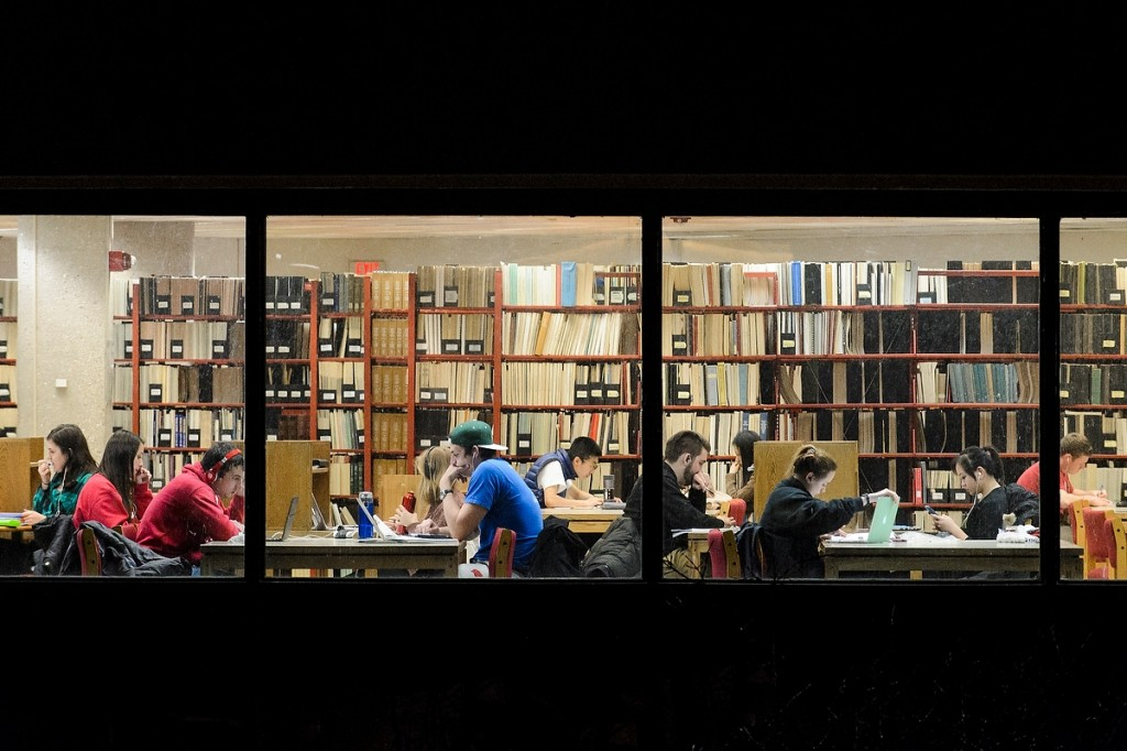 Students hunker down inside Wendt Library to study for final exams.