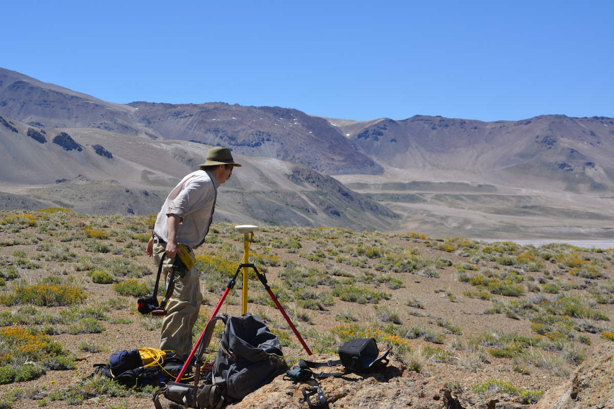 Basil Tikoff, professor of geoscience at UW–Madison, uses a precise GPS instrument to record shoreline altitude at Laguna del Maule.
