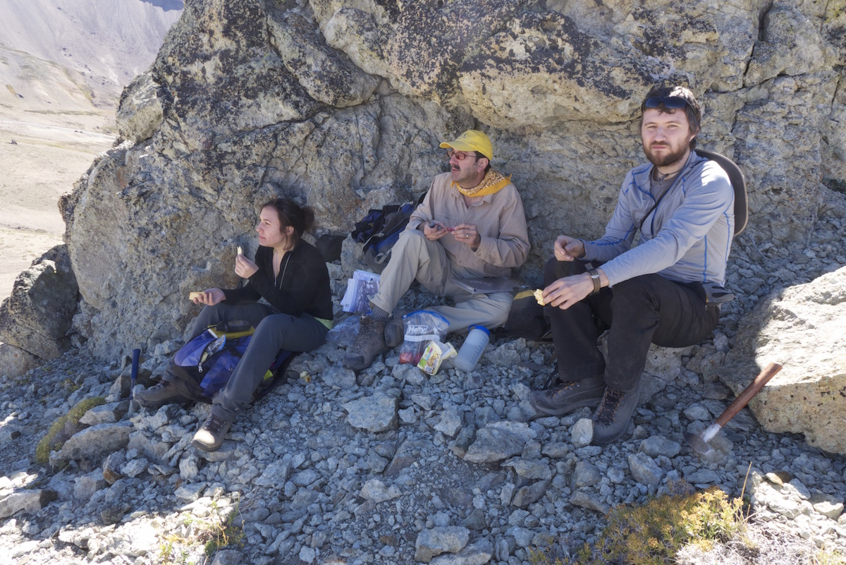 Brad Singer, center, stops for lunch with students Erin Birsic, left, and Nathan Andersen. The trio were collecting rocks that they will date to document the timing of the many lava flows at Laguna del Maule.