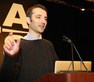 Sebastian Heinz presents a lecture to the American Astronomical Society in 2014.
