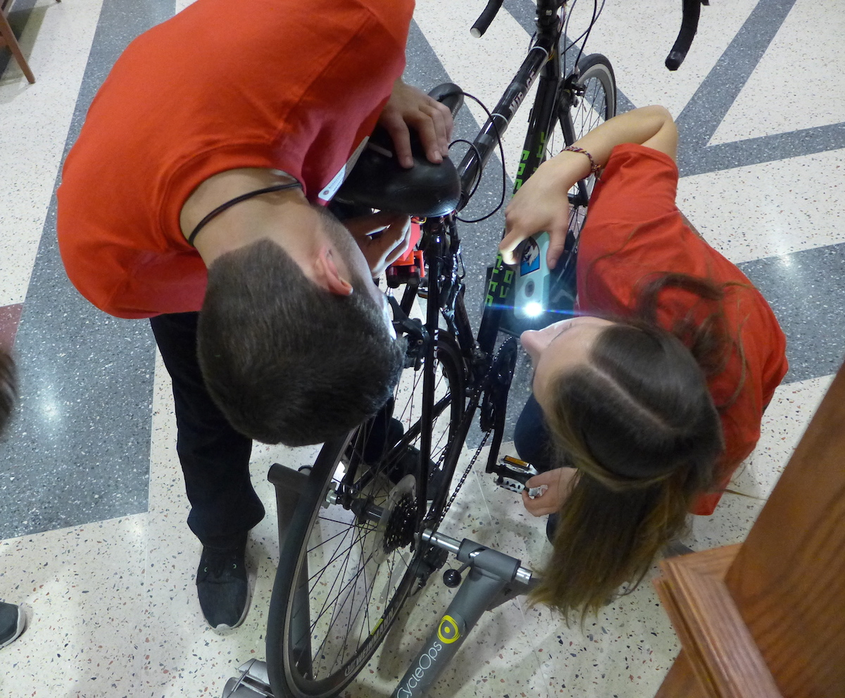 Will Caldwell and Katie Miller prepare the Safe Cycle device for the Internet of Things Open House on Dec. 11. Safe Cycle is designed to alert a bicycle rider to traffic behind the bike.