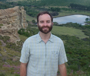 John Pool collects fruit flies in Ethiopia and other parts of Africa (such as here above a cherry farm in South Africa).