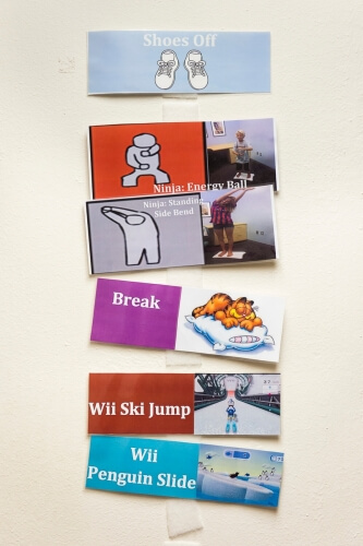 Visual cards depict the order of movements that children practice as they participate in the balance study.