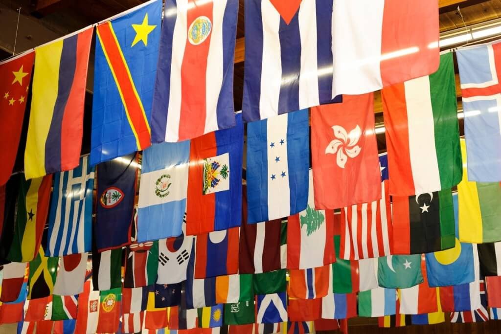 International flags representing countries around the world hang from the ceiling during a Turkish-American friendship dinner at UW–Madison's Eagle Heights Community Center in 2013.