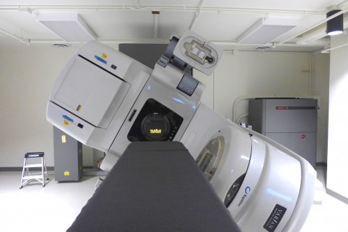 A modern medical linear accelerator at the Radiation Calibration Laboratory is used for graduate student experiments and education related to verifying radiation doses for cancer treatment.