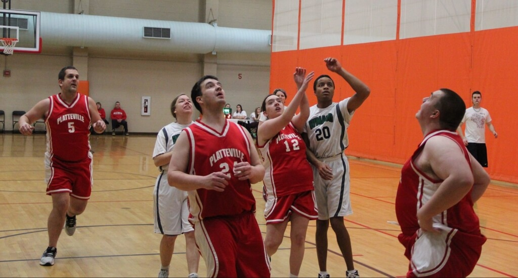 Teams battle it out under the basket in a recent Special Olympics tournament, hosted at the SERF by the student group Badgers For Special Olympics (BFSO).