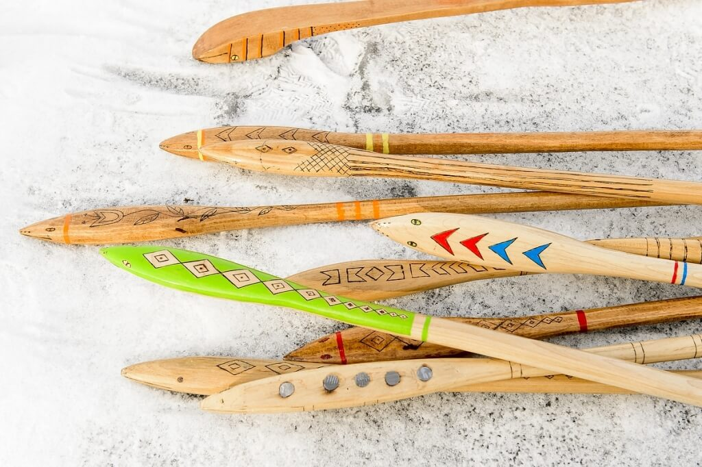A collection of snow snakes sits waiting to be used at Ojibwe Winter Games, held on Lake Mendota at the University of Wisconsin-Madison on Feb. 5, 2016. Events included snow snake, hoop and spear, and atlatl, where participants propel an arrow with a hooked handle.