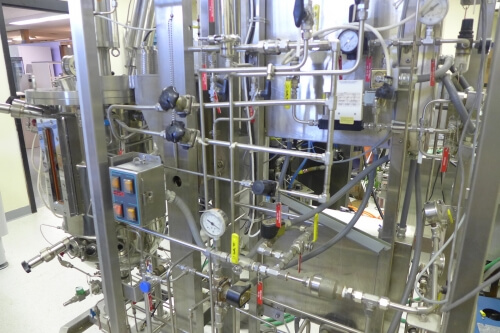 Feed ports, valves, gauges and apparatus needed to control the fermenter at left.
