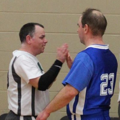 Opposing athletes high-five after a game.