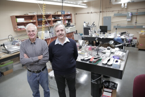 J. Ashley Taylor (left) and Tom Krupenkin showing prototypes in their lab.