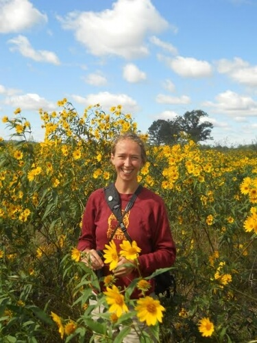 Amy Alstad stands in a bunch of Sawtooth Sunflowers that she describes as glorious.