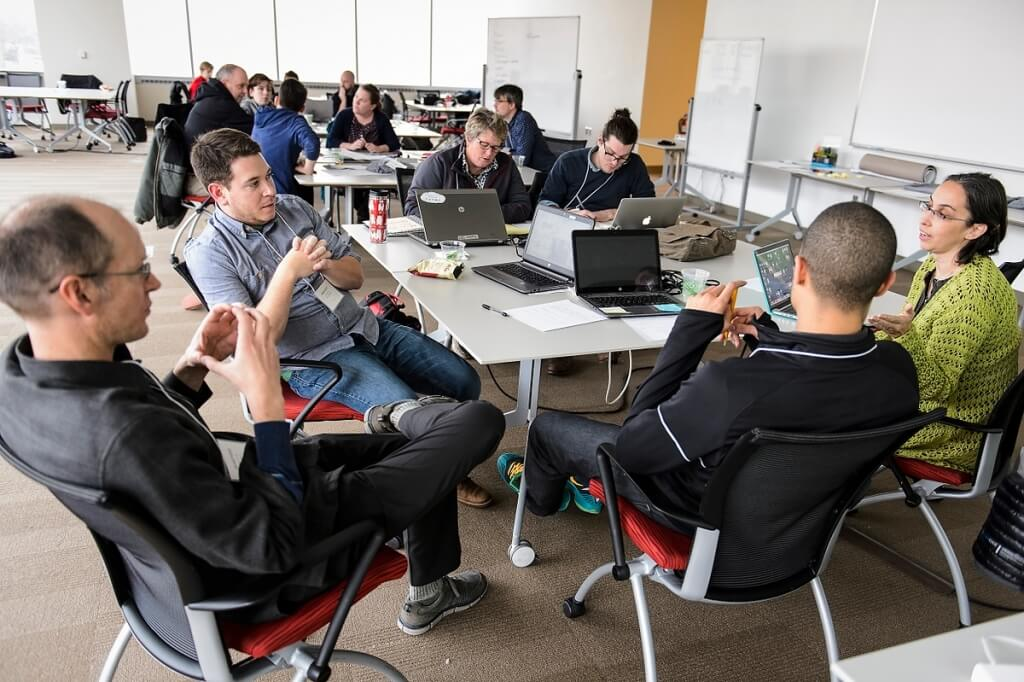 A group of Wisconsin middle school science teachers work in teams as they collaborate with UW–Madison staff and experienced computer game designers during a workshop held at the Wisconsin Institute for Discovery.