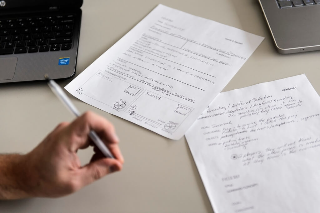 Collaborators shared notes on game ideas and concepts, listing goals and challenges while sketching out suggested screenshots.