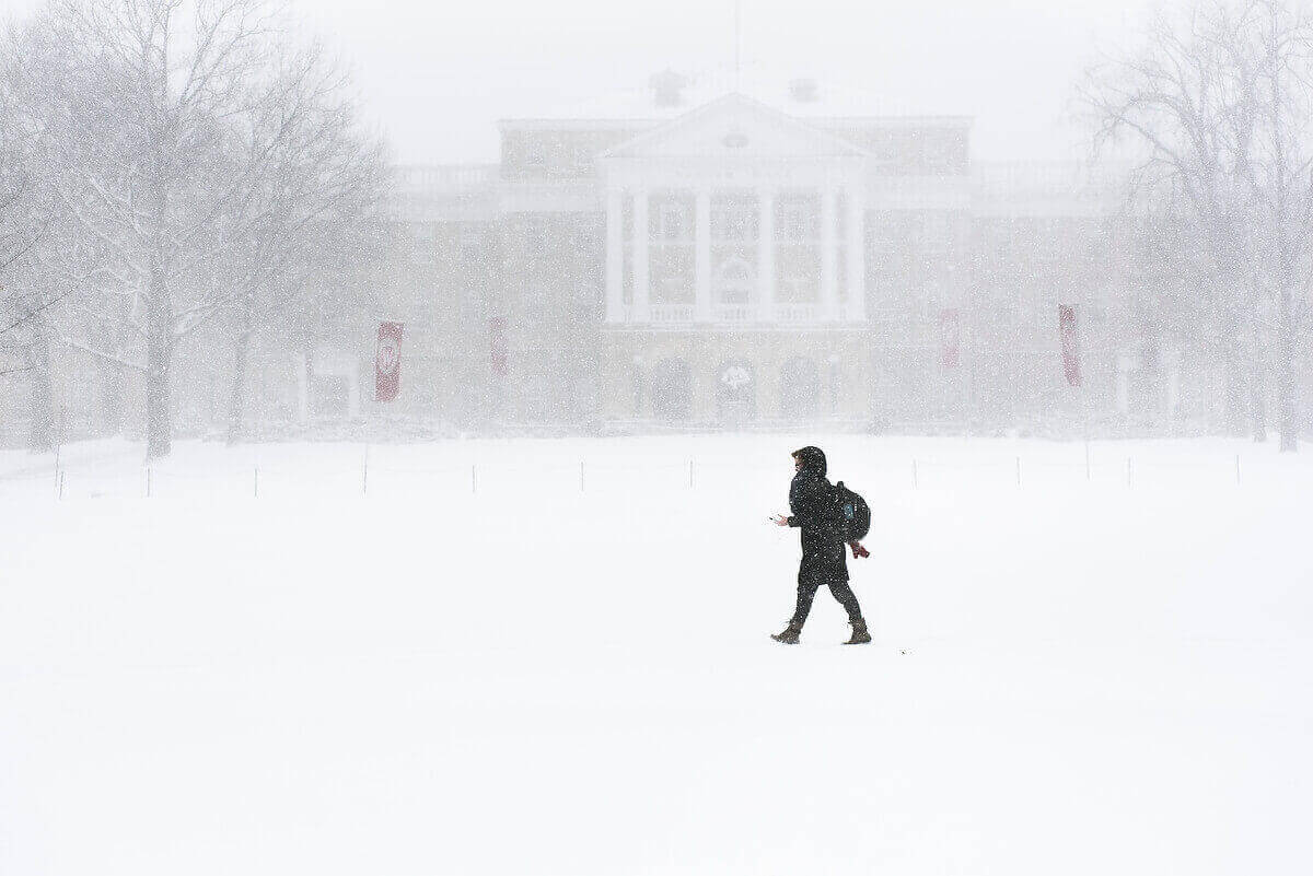Photo: Pedestrian walking through snow on Bascom Hill