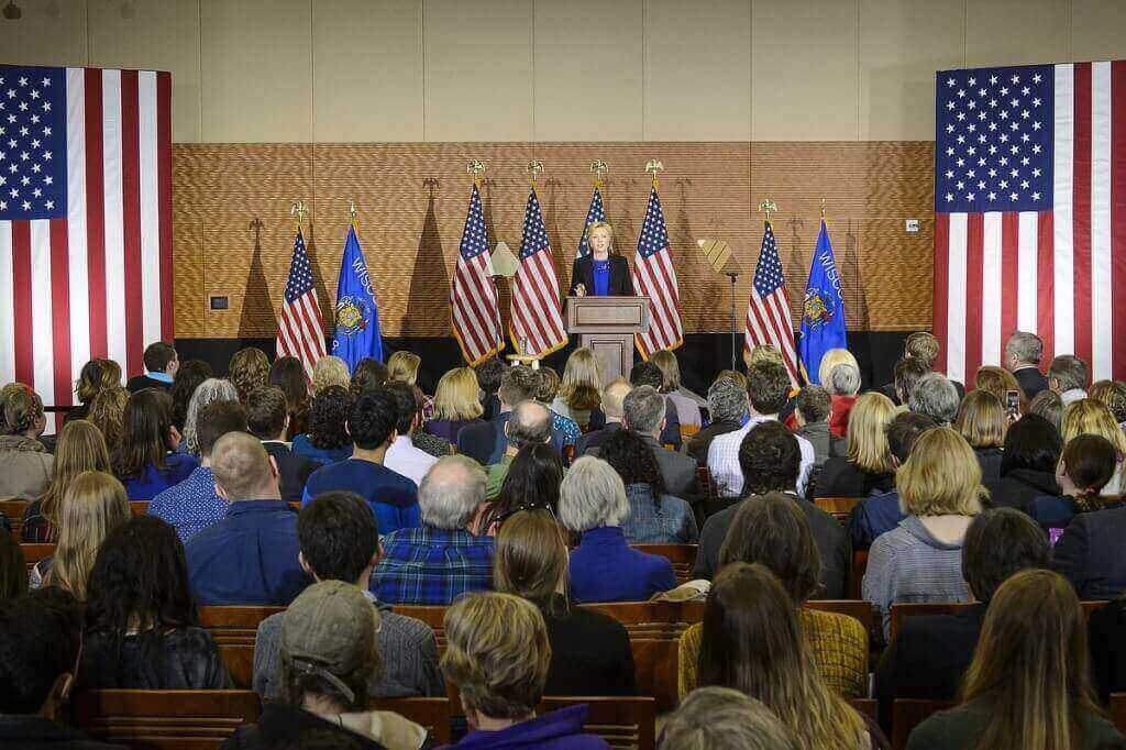 Photo: Hillary Clinton speaking to roomful of spectators