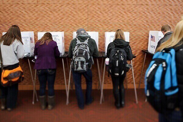 Students fill out their ballots at a polling station in the Gordon Dining and Event Center during the November 2012 election.