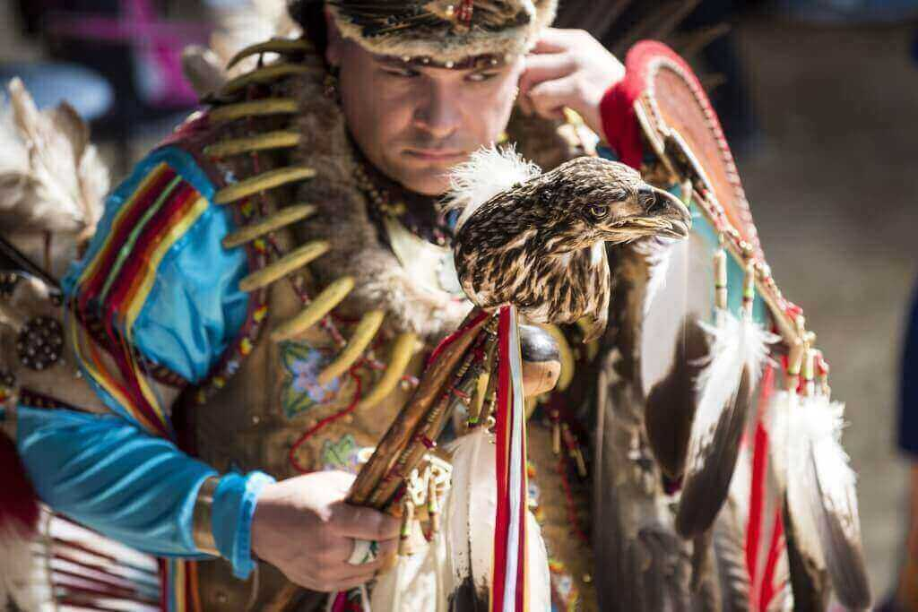 Head Dancer Joe Syrette, a member of the Ojibiwe tribe from Batchewana, Ontario, holds an eagle head staff during a Spring Powwow held on campus in 2014.