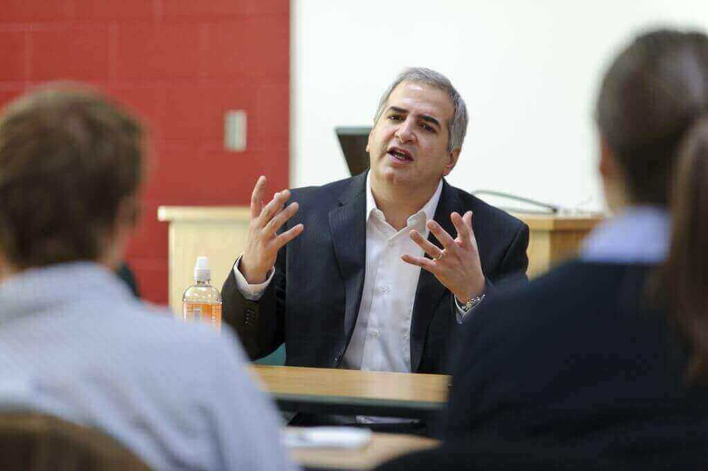 Anthony Shadid (center) speaks to a group of journalism students in a Vilas Hall classroom in December 2010.