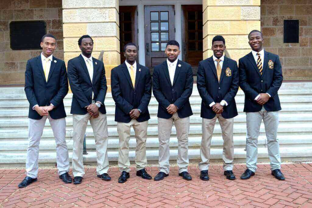 Keven Stonewall, second from left, poses with his Alpha Phi Alpha fraternity brothers.