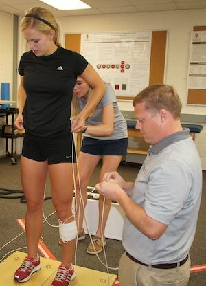 UW-Madison assistant Professor David Bell examines a student athletic participant at the Wisconsin Injury in Sport Laboratory, which he directs.
