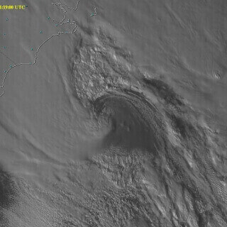 Still image from <a href='https://www.youtube.com/embed/EHPHsvzuXsI'>Massive Storm System movie</a>: One-minute interval Super Rapid Scan Operations for GOES-R (SRSO-R) visible images from the GOES-14 satellite showed the development and rapid intensification of a massive storm system off the East Coast of the U.S. on Feb. 7, 2016. The storm produced moderate to heavy rainfall across eastern North Carolina along with light to moderate snow in places.The 1-minute interval images revealed the rapid motion of low-altitude clouds when gaps in the high-altitude clouds were present. Strong winds were produced by the storm (with gusts as high as 72 mph) and a large Royal Caribbean cruise ship experienced damage due to the winds, forcing a canceled voyage and return to port. • Image by Scott Bachmeier, academic staff | GOES satellite data was ingested by antennas at the UW-Madison Space Science and Engineering Center, and processed using McIDAS software.