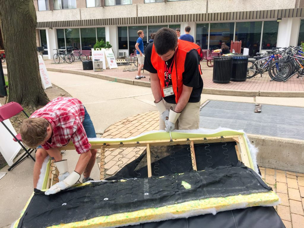 Volunteers salvage usable material from a discarded futon during last year's University Residence Halls move-out.